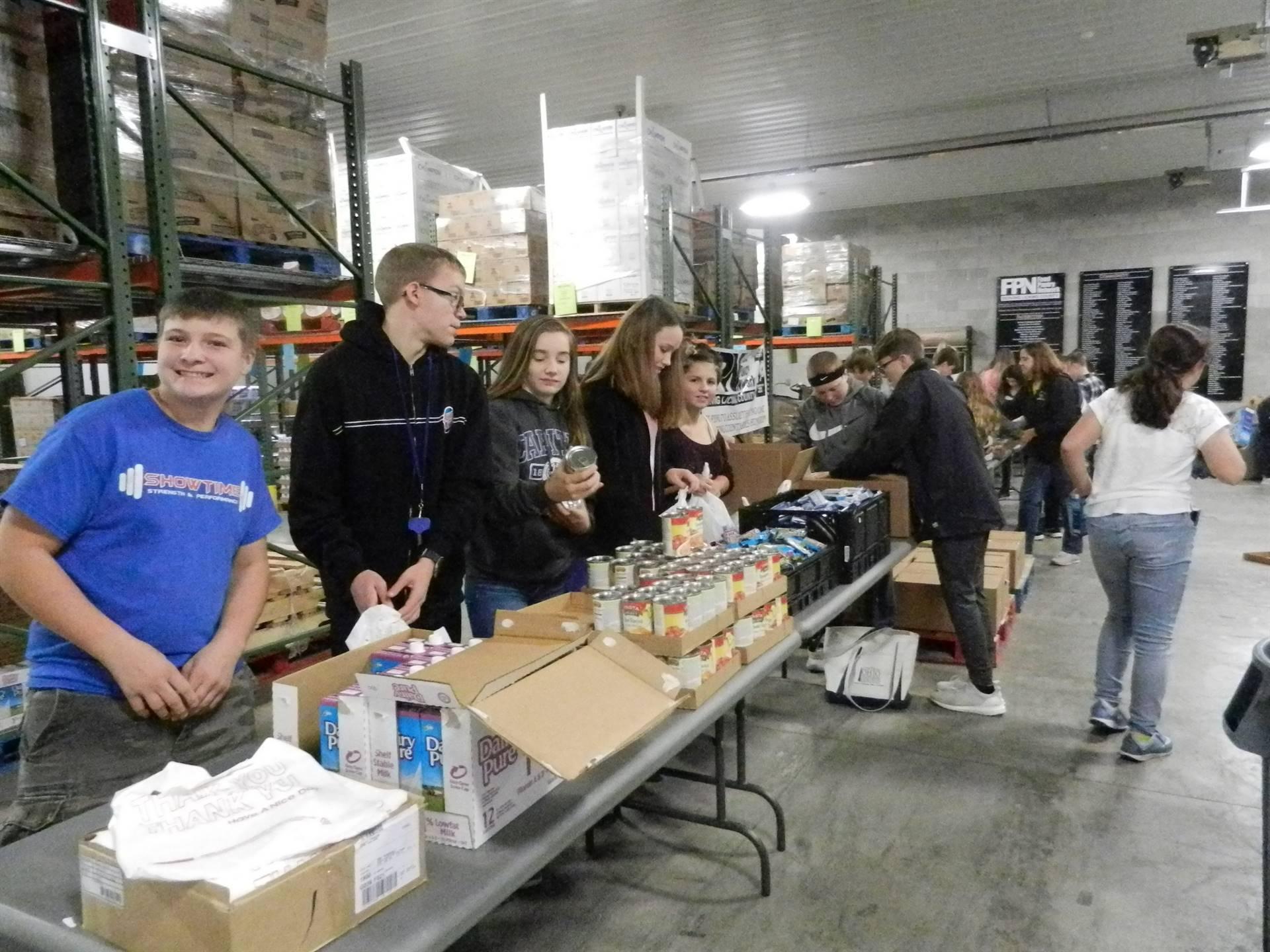 GMS Students Load Weekend Backpacks at Food Pantry