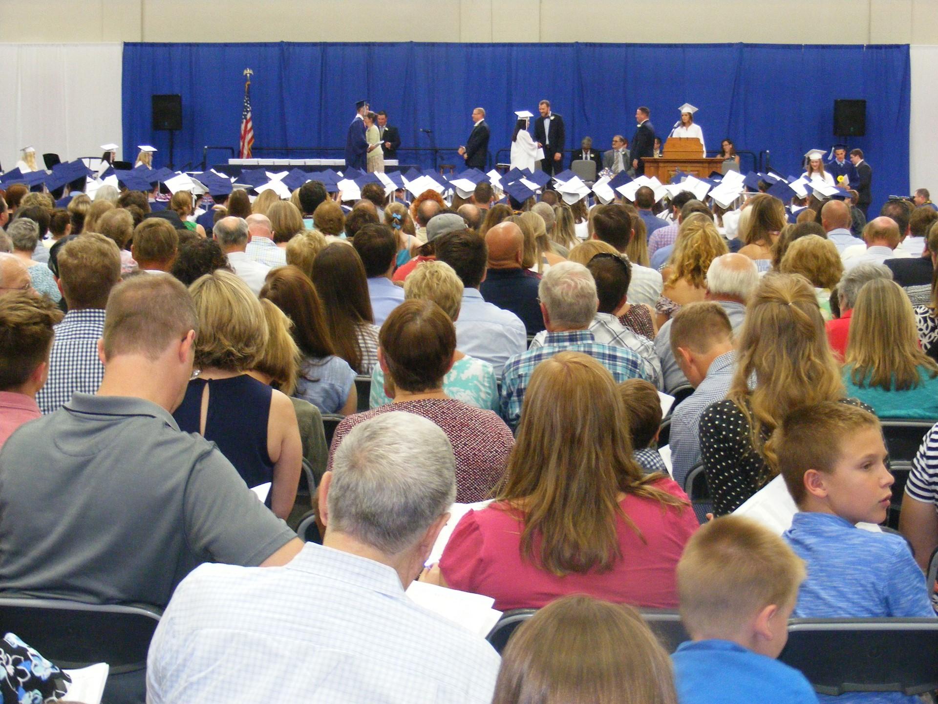 Presenting Diplomas to the Graduates