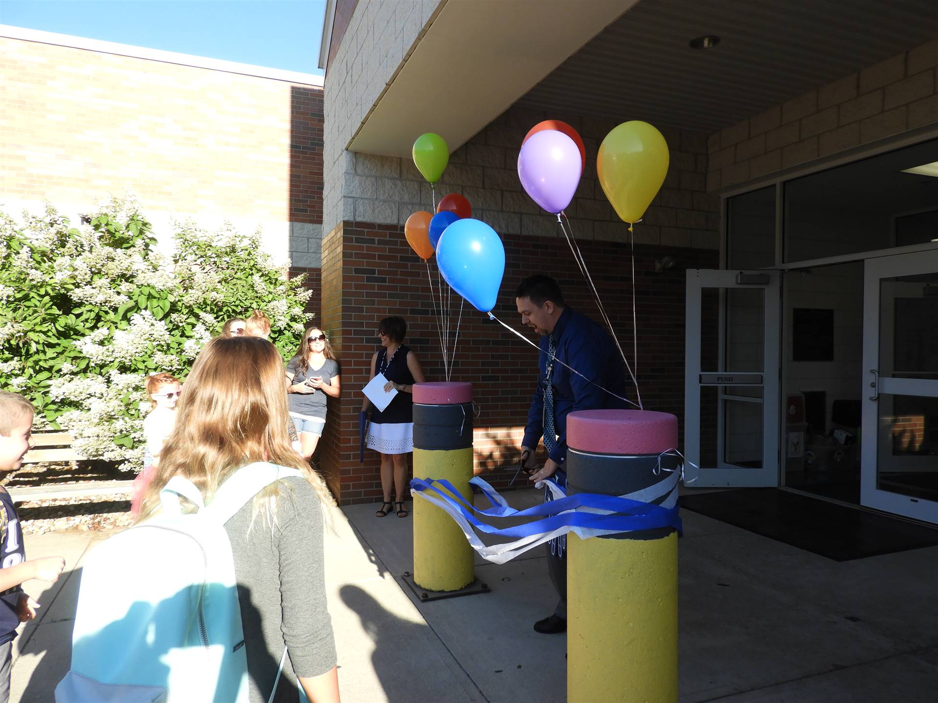 Principal Travis Morris Cut the Ribbon for the First Day of School