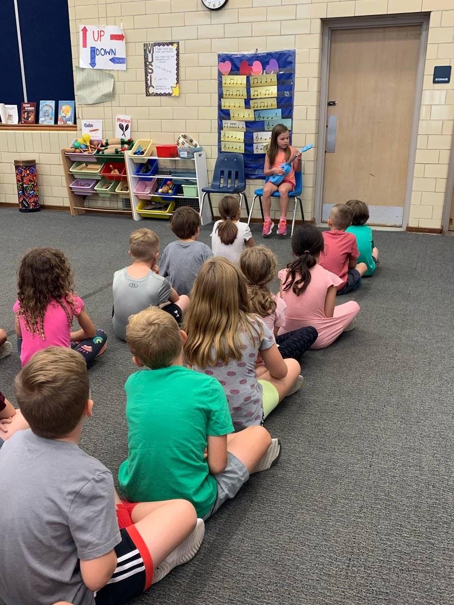 Second grader plays ukelele to classmates