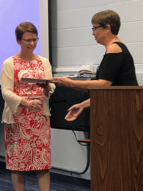 August 2019 Board Member Dr. Jennifer Cornman receiving commendation from OSBA