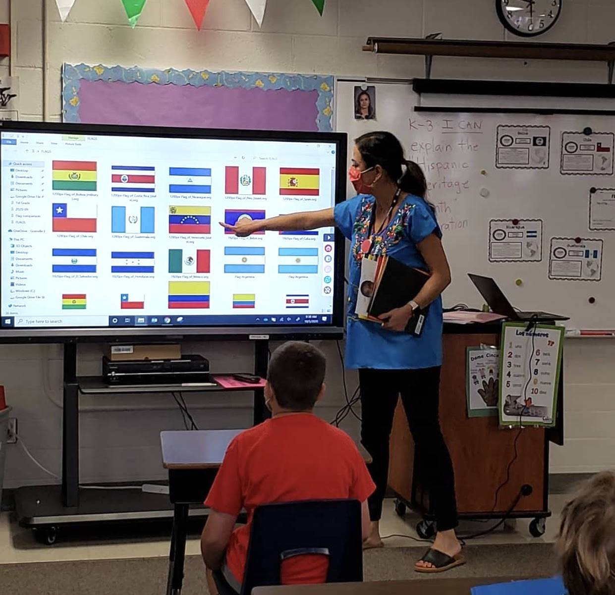 GES Global Language teacher, Adriana Spencer, comparing flags of Spanish speaking countries