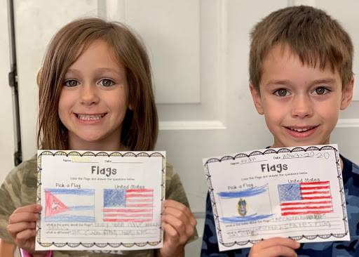 GES remote learners show their flag project created in Global Language class.